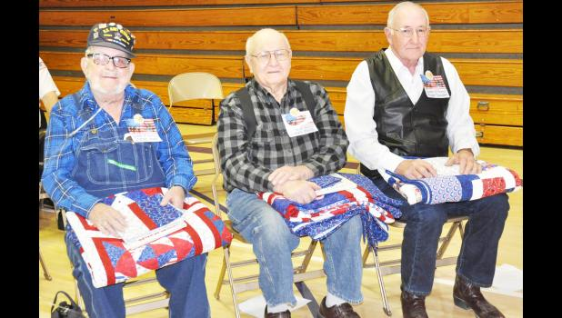 From left, local veterans Charles Jewell of Mayetta, Melvin Wells of Holton and Roger Gooderl of Hoyt were selected to receive Quilts of Valor as part of a special Veterans Day program at Royal Valley Middle School Friday. The quilts were made by members of last year's sixth-grade class at the district. (Photo by Ali Holcomb)