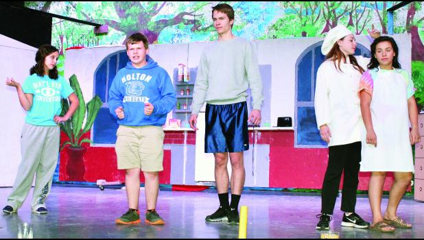 """From left to right, Holton High School students Savannah Phillips, Walker Sheldon, Ian McAsey, Taylor Stevens and Sydney Snyder rehearse a scene from """"The Drowsy Chaperone,"""" a """"comedy within a musical"""" to be presented Saturday and Sunday in the HHS auditorium."""