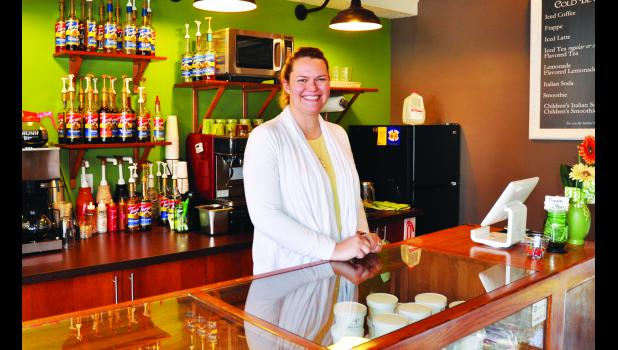 Erin (shown above) and Dr. Vance Lassey of Holton have opened Penny's on the west side of the Square. The front portion of the building serves as a coffee shop while the back of the building has been remodeled as a large event space available to rent.