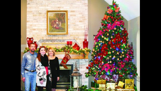 "The Wilkerson family, which includes (from left) Les, Rosalie and Rosemary, are showcasing their holiday decor during the Dec. 6 ""I'll Be Home for Christmas"" homes tour. The tour features five local homes and is a fund-raiser for the Holton/Jackson County Chamber of Commerce."