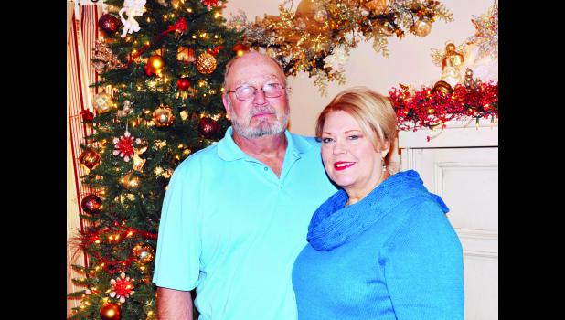 "Phillip and Ginger Lloyd (shown above) are one of five families included on this year's ""I'll Be Home For Christmas"" homes tour. The Lloyds have an expansive collection of Christmas decor  at their home south of Holton."