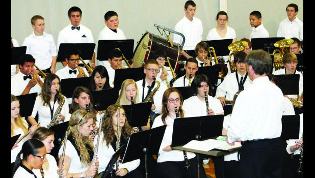 "Royal Valley High School held its winter music concert on Thursday in Hoyt. The photo above shows John Nottingham (director) leading members of the RVHS band in one of three songs, including ""I Saw Three Ships,"" ""Santa Claus Is Comin' To Town"" and ""Up On A Housetop."" A video of the band's performance can be found on The Holton Recorder website."