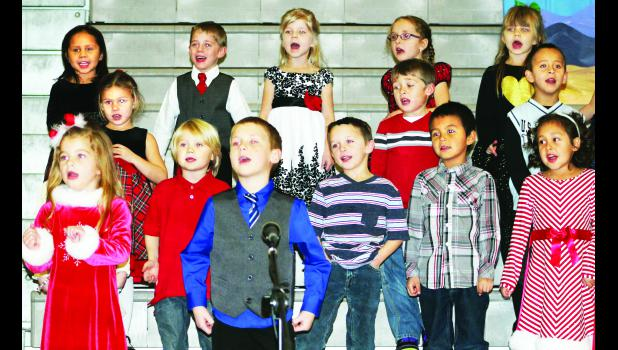 "Members of Royal Valley Elementary School's kindergarten class held their winter program last week at the high school gym in Hoyt. The students sang several songs under the direction of Melissa Kimble including ""Let's Build A Gingerbread House,"" ""Winter Wiggles"" and ""Hip Hop Elves."" Holton and Jackson Heights have holiday concerts planned throughout this week."