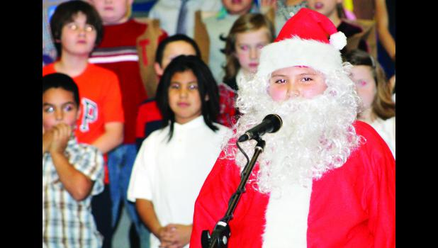 "Santa, played by Mikey Wamego, helped usher in ""A Relaxing Christmas,"" with help from his elves and reindeer. Third and fourth grade students at Royal Valley held their winter program last week that featured a holiday parade, hip hop turkeys and the rules for Christmas."