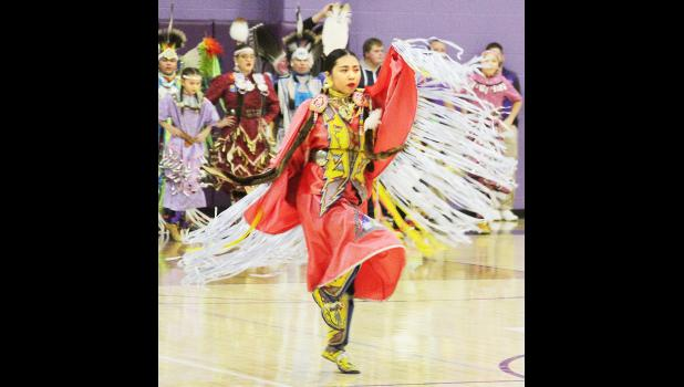 USD 337 Royal Valley, in collaboration with the Prairie Band Potawatomi Nation, hosted the second annual Cultural Heritage Night at Royal Valley High School during the Panthers' home basketball games against Holton. Here, Dania Wahwassuck of Mayetta, a student at Haskell Indian Nations University in Lawrence, danced in traditional regalia during the event. (Photo by Michael Powls)