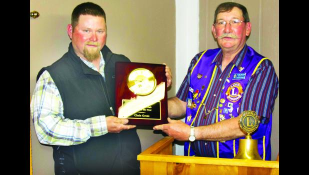 Chris Gross (left) is shown receiving the Farmer of the Year Award from Holton Lions Club member Allen Arnold (right).