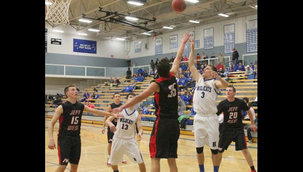 Wildcat Trey Tanking (shown above, front right) floats a shot over a Jeff West defender in last Tuesday's game. Tanking and his Holton teammates were strong on both ends of the floor on the way to a 74-44 victory.