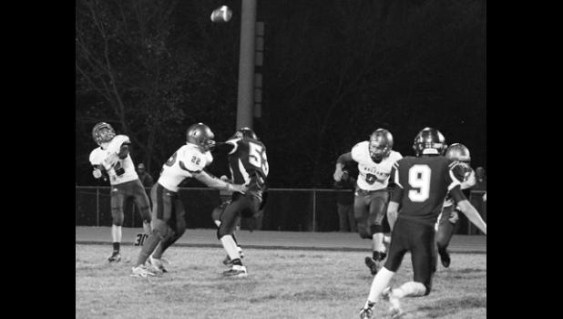 Wildcat quarterback Justin Rieschick (shown above, far left) lets a pass fly during the first half of the district battle against Royal Valley. HHS stuck to the ground through most of the night, though, in a big win over RV.