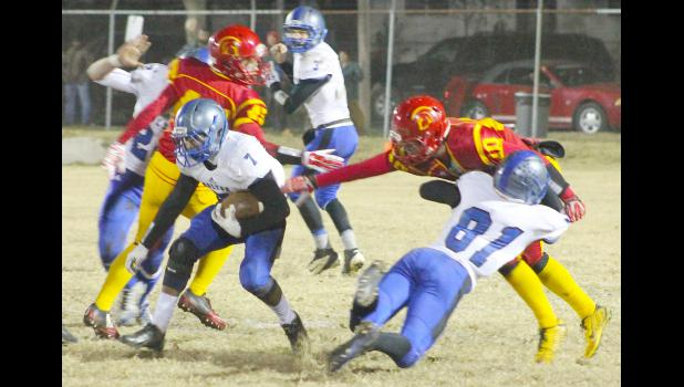 HHS tight end Nils Bergsten (shown above, right) lays out for a block in order to spring RB Luis Butto (left) for a big run in the sectional game against Columbus. Butto had an impressive night for Holton, finishing with 145 total rushing yards and one touchdown on 14 carries, but the Wildcats came up just short in a 22-21 loss.