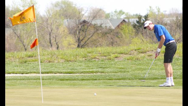Wildcat golfer Kaden Brandt (shown above) sinks a long putt from the fringe during tournament action in Seneca.