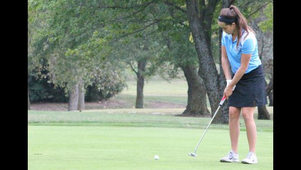 Holton golfer Cali Smith (shown above) tries to tap a putt in during competition in Topeka earlier this season. Smith and the rest of the Wildcats turned in some of their top scores in regional competition last week, coming just a few strokes short of qualifying for state as a team.