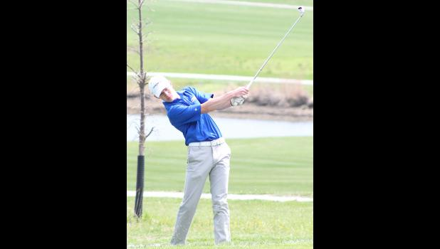 Holton's A.J. Haussler (shown above) makes an approach shot with an iron at the recent Nemaha Valley Invitational. Haussler is one HHS golfer who continues to show improvement, something coach Don Swisher noted all of the Wildcats will need to do moving forward.