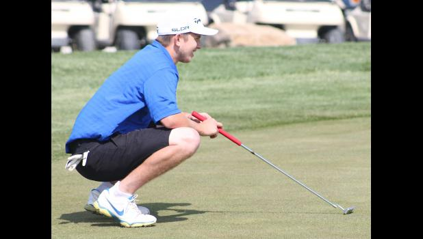 HHS golfer Braden Sides (shown above) analyzes the green to try and line up his putt perfectly during tournament competition.