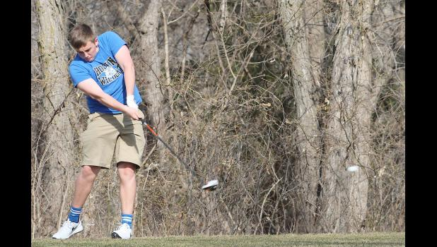 Holton's Hayden May (shown above) tees off during a practice round earlier this spring. With a wide open competition to fill the varsity roster, according to coach Don Swisher, May and any other number of Wildcats could contribute to the team this spring.