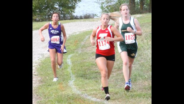 Jackson Heights' Hanna Davault (shown above, at right) looks to pass late in Thursday's race while Royal Valley's Kiikto Thomas (left) comes up from behind. Davault and the Cobras made some strong debuts in the team's first meet of the season.