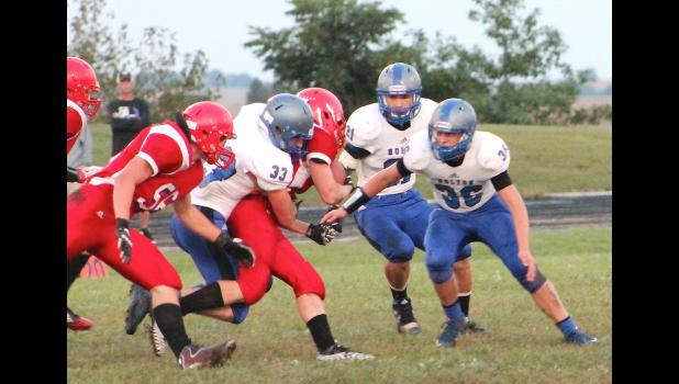 Holton's Austin Frakes (#33) tracks down a Hiawatha ball carrier from behind while teammate Dylan Aeschliman (front right) looks to assist on the tackle during the recent Big Seven League clash.