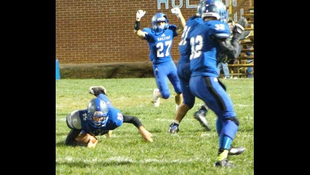 Holton's Bryson Patch (shown above, bottom left) dives forward to grab an interception off a tipped pass late in Friday's game against Perry-Lecompton. After some early trouble, HHS dominated the final three quarters on the way to a 28-6 victory over the Kaws.