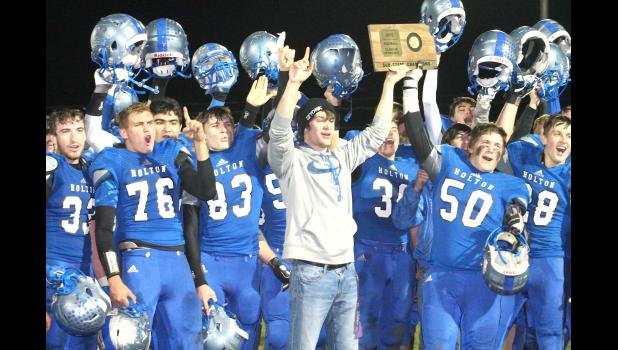The Holton High School football players celebrate a come-from-behind 23-22 victory over Columbus in the sub-state round of the playoffs, which earned them a spot in the 4A-DII state championship game.