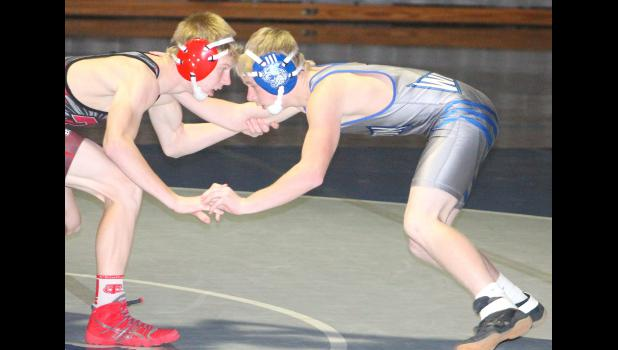 Wildcat Lawson Henry (shown above, at right) grapples with an opponent from Tonganoxie during a dual earlier this season. Henry is one of several young wrestlers who keep coming along for the HHS wrestling team this winter.
