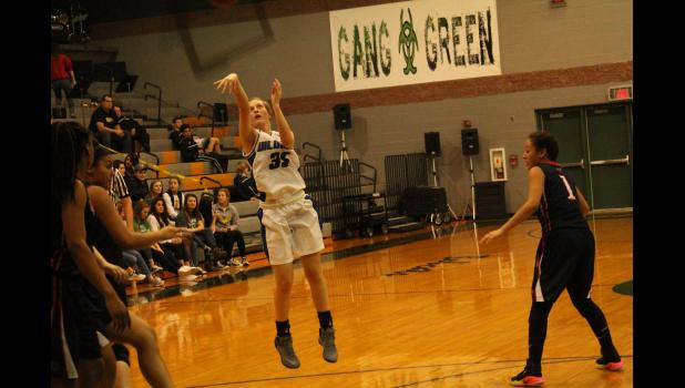 Holton junior Maleah Price (35 white jersey)  shoots a long two-pointer in the champtionship game  against Olathe North at the Basehor-Linwood Invitational this past weekend.