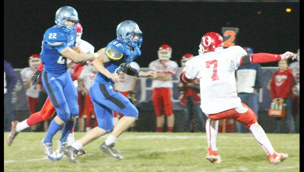 HHS running back Indie Allen (shown above, left) follows lineman Dean Klahr (middle left) on one of his three touchdown runs in Holton's 54-8 regional win over Osawatomie.