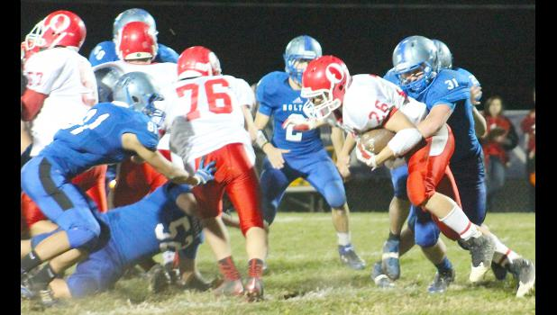 Wildcat Derek Haverkamp (shown above, right) crashes in from the backside and makes a tackle for loss in the regional battle against Osawatomie.