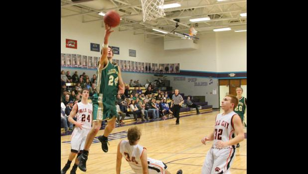Jackson Heights' Zane Richter (shown above, at left) slashes to the basket for two of his 30 points in the championship game of the Thunder Classic tournament against Falls City (Neb.). That effort pushed Richter into the record books, as his 101 total points through the week set a new high mark for points in a single tournament.