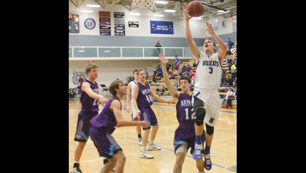 Wildcat Trey Tanking (shown above, at right) cuts to the basket for two of his 23 points in last Friday's key 68-58 victory over Nemaha Central.