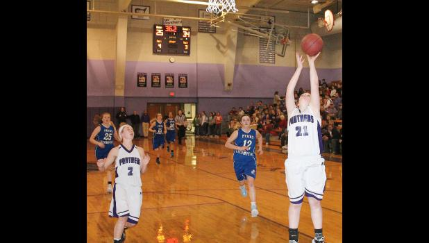 Royal Valley's Lexi Baker (shown above, at right) drives in for two points during a fast break in the second half of Tuesday's game against Perry-Lecompton. Those opportunities were key for the Panthers, as the defense helped fuel the team to a 40-38 victory over the Kaws.