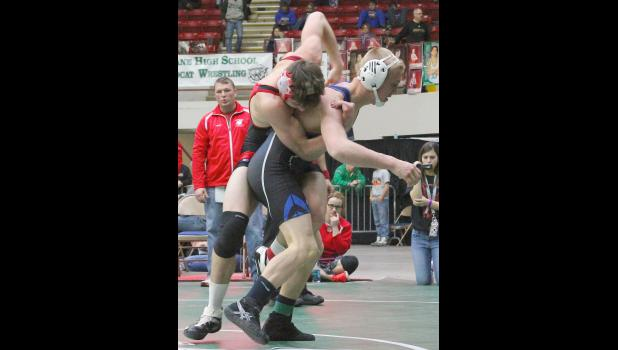 Wildcat Mason Baum (shown above, at right) works to break free from his opponent's grasp in an early match-up at the state tournament. Baum worked his way through the consolation bracket on Saturday to claim a fifth-place medal.