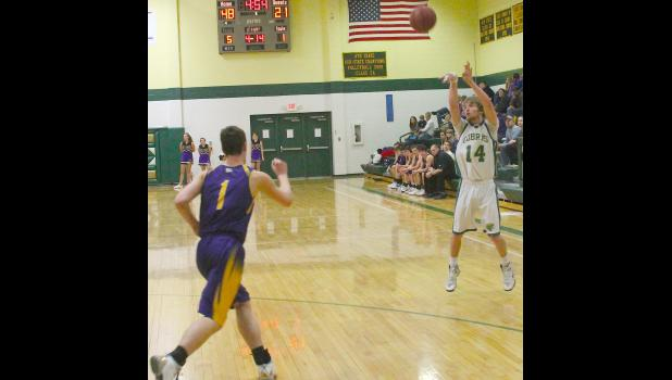 Cobra Korby Strube (shown above, at right) launches a three-point attempt in the second half of Monday's game against McLouth. Strube poured in 17 points in the game to help Heights pick up a 77-40 victory over the Bulldogs.