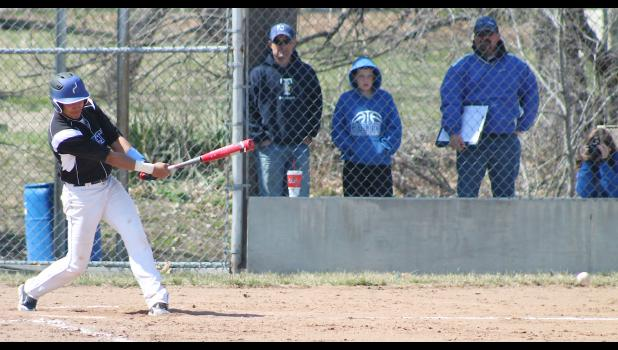 Wildcat Luis Butto (shown above) gets a hold of a pitch and puts it in play during the first game of Holton's home doubleheader against Falls City to start the season. Butto came through with a big RBI double to help HHS start the season with an 8-2 victory over the Tigers.