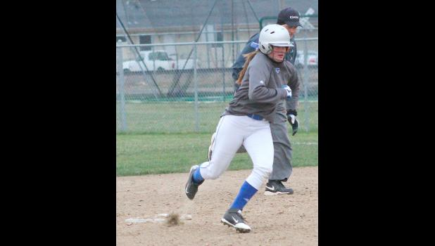 Holton's Brianna Boyett (shown above) rounds second base in a big inning in the second game of the night against the Thunder last Thursday. Boyett and the bottom of the batting order had some big contributions to help HHS to a 13-2 victory.