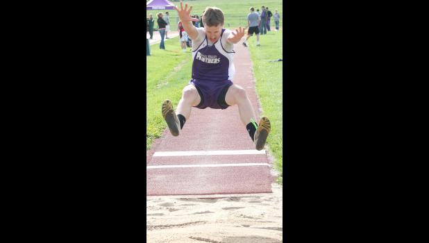 Royal Valley's Lucas Broxterman (shown above) soars through the air during an attempt in the finals of the boys long jump at the team's home meet on Tuesday. Broxterman and some other young athletes have come to the forefront to help the RVHS track team get off to a strong start this spring.