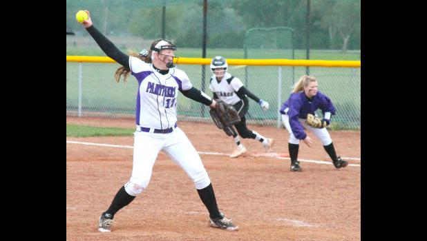 Panther pitcher Kaileigh Gray-Milligan (shown above, left) winds up and gets ready to deliver a pitch in Tuesday's 4A-DII regional championship game against Rock Creek. Gray-Milligan held her own in what turned into a pitcher's dual, but RV still came up just short in a 3-1 loss.