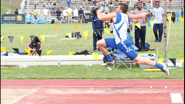 Holton's Indie Allen (shown above) takes a flying leap at the end of the triple jump runway, soaring into the pit during one of his attempts in the finals. Allen ended up taking fourth in the event, walking away from his final high school meet with a state medal.