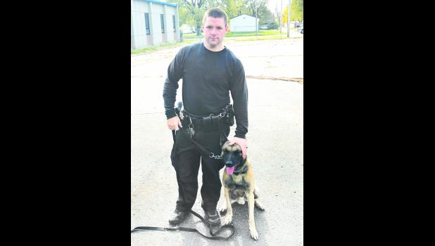 Jackson County Deputy Sergeant Travis Spiker is shown above with Ike, a Belgian Malinois and a new member of the county's K-9 unit.