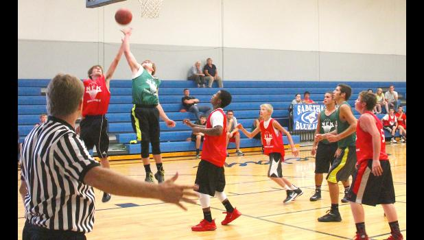 Jackson Heights' Mason Thomas (second from back left) skies up and tries to corral a rebound in summer basketball action at the season-ending tournament, which JH would go on to win, in Sabetha recently.