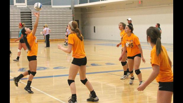 Cobra Trista Reed (shown above, at left) sets up her teammates for an offensive attack during recent summer volleyball action. While coach Kaylee Mick noted there were some nerves on the first night, she said the team quickly settled in and realized what it could do.