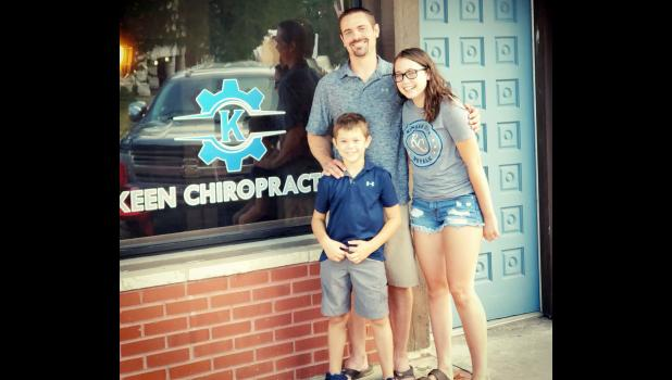 Holton native Dr. Jim Keen, shown here with his children Lexi and Logan, is returning to Holton to open a chiropractic office on the south side of Holton's Town Square. (Submitted photo)