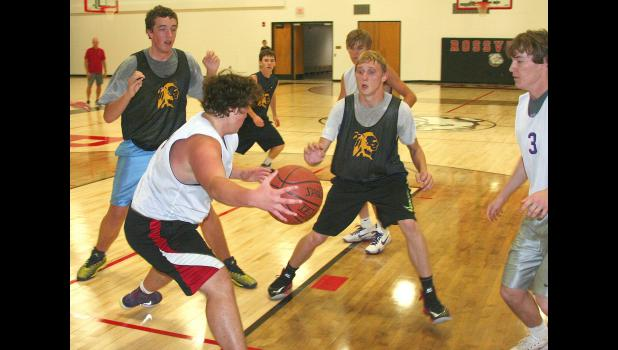 Panther Jarrett Roy (shown above, front left) tries to corral a loose ball for a rebound in a summer league game held at Rossville recently.