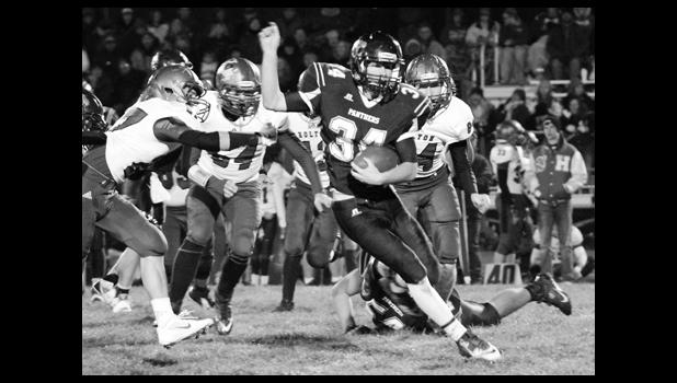 Panther RB Derrick Barger (shown above, middle) tries to break free from the grasp of Wildcat Justin Pool (left) in the midst of a long run that set up RV's lone touchdown in a 51-6 loss.