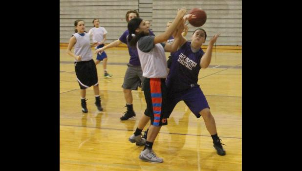 Royal Valley's Kate Hanson (shown above, right) and Bella Thompson (middle) fight for a loose ball as the Panthers worked on their pressure defense during a recent practice.