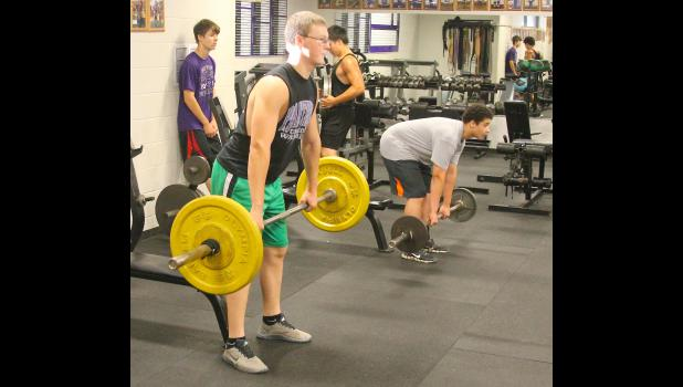 Royal Valley's Jacob Box (shown above, left) and Marshall Stewart (right) work on their clean technique at a recent summer weights session at RVHS.