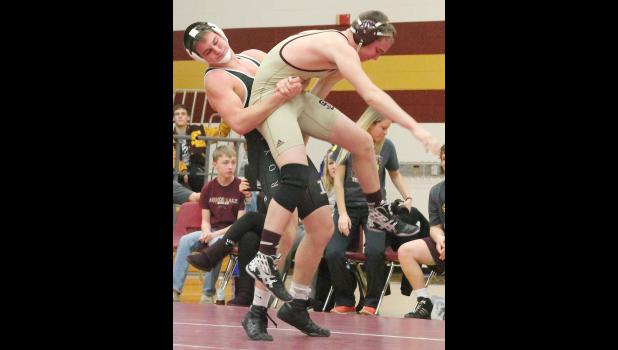Royal Valley's Matthew Bailey (shown above, left) picks up his opponent from Silver Lake before throwing him to the mat in dual action last week. Bailey continued to look strong in his return to action, picking up two more wins in the double dual.