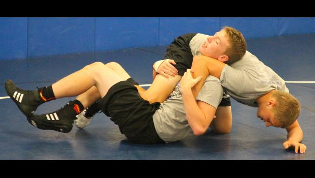 HHS wrestler Ethan Brownell (shown above, at left) tries to reverse out of a pin attempt by teammate Damon Ruckman as the young Wildcats fine-tuned their technique during the team camp held recently. Brownell and Ruckman are part of a young class that could be crucial to Holton's success next winter after the departure of another strong group of senior wrestlers.