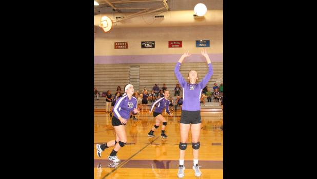 Royal Valley's Ali Bryan (No. 3) sets the volleyball for hitters Grace Harvey (No. 26) and Danielle Stithem (No. 4) Tuesday night against ACCHS.
