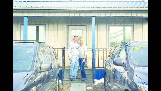 Scott and Susan Baum are shown above standing in front of the new office building for Robert Baum Motors. The business, which is located along U.S. Highway 75, has been serving northeast Kansans for 29 years.