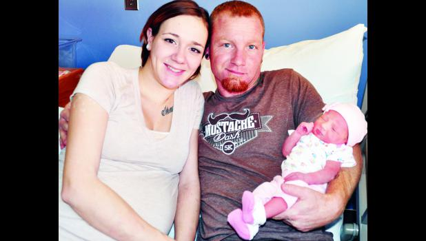 New Holton residents Brandi Lopez (left) and Shaun Gates are the proud parents of Harley Raelynn Gates, the first baby born in 2015 at Holton Community Hospital.