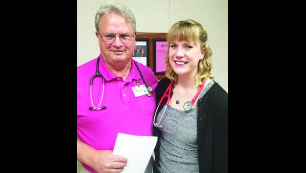 Anne Valburg (right), a medical student at The University of Kansas, is shown with Dr. Joel Hutchins at Holton Community Hospital. Valburg graduated from Holton HIgh School in 2000 and is completing a medical rotation at the hospital and clinic.